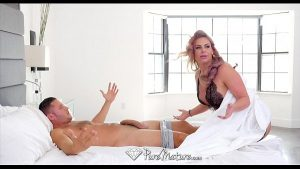 Image PureMature – Big breasted Phoenix Marie slobbers all over cock